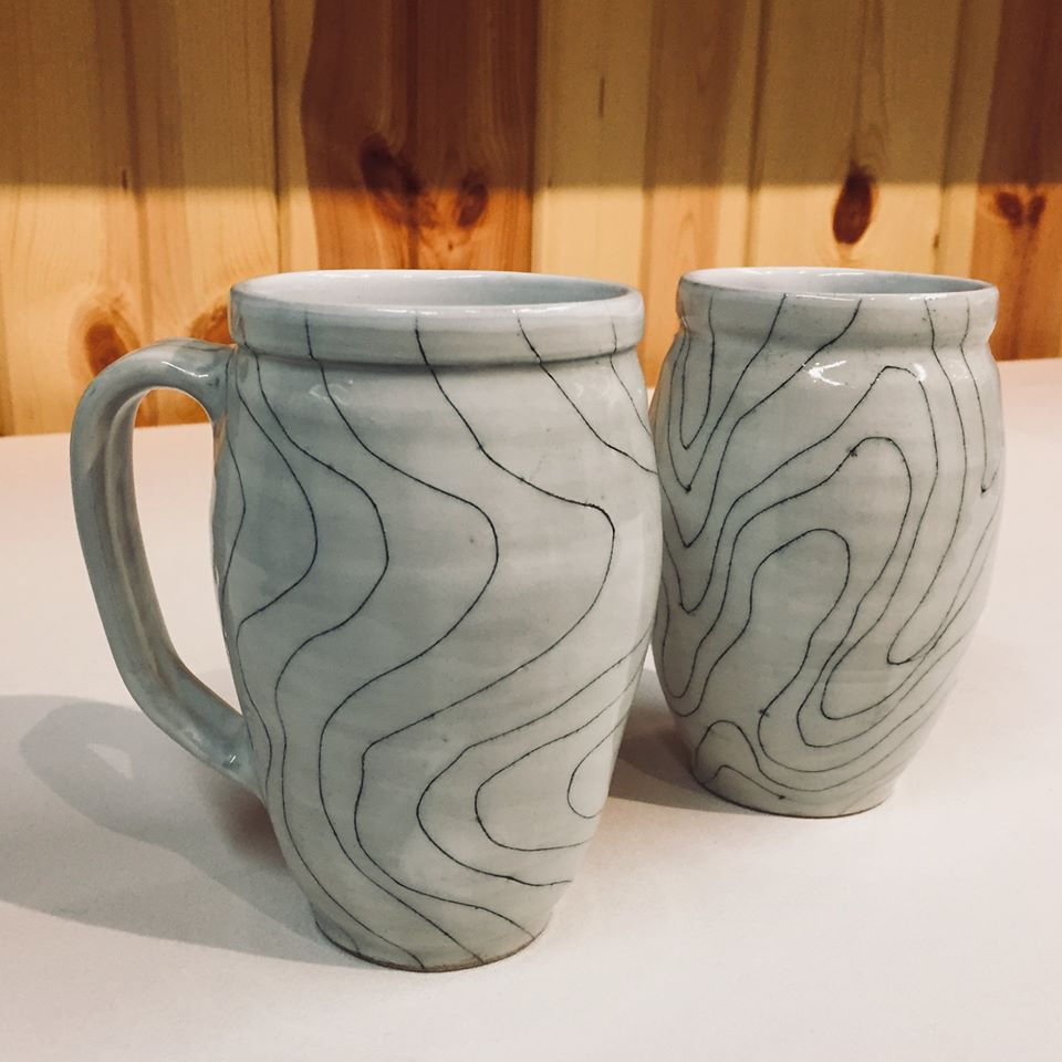 two gray mugs with thin black lines